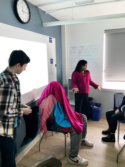 Here, Keka is delivering an intimate and interactive classroom workshop that is part of her highly-sought after Gratitude Mirrors program.
