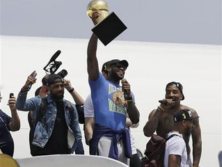 OFF THE PLANE BUT STILL SKY-HIGH, LEBRON BRINGS TITLE HOME