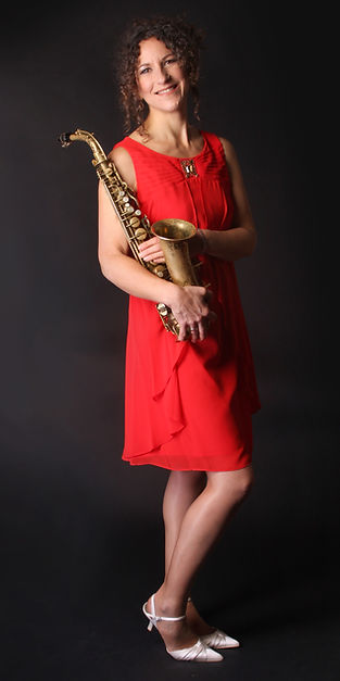 Beccy rork saxophonist plays with a wide variety of bands in South East England
