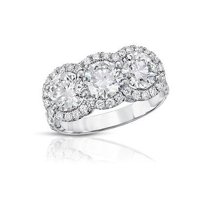 18K THREE-STONE DIAMOND RING