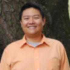 Dr. Chou smiling