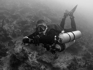 Tec Sidemount Diver wearing multiple cylinders