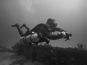 Sidemount diver diving on a shipwreck