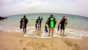 scuba divers heading to a dive site