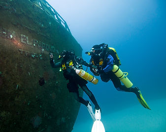 technical divers on a shipwreck