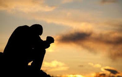 Kneeling in Prayer pic.jpeg
