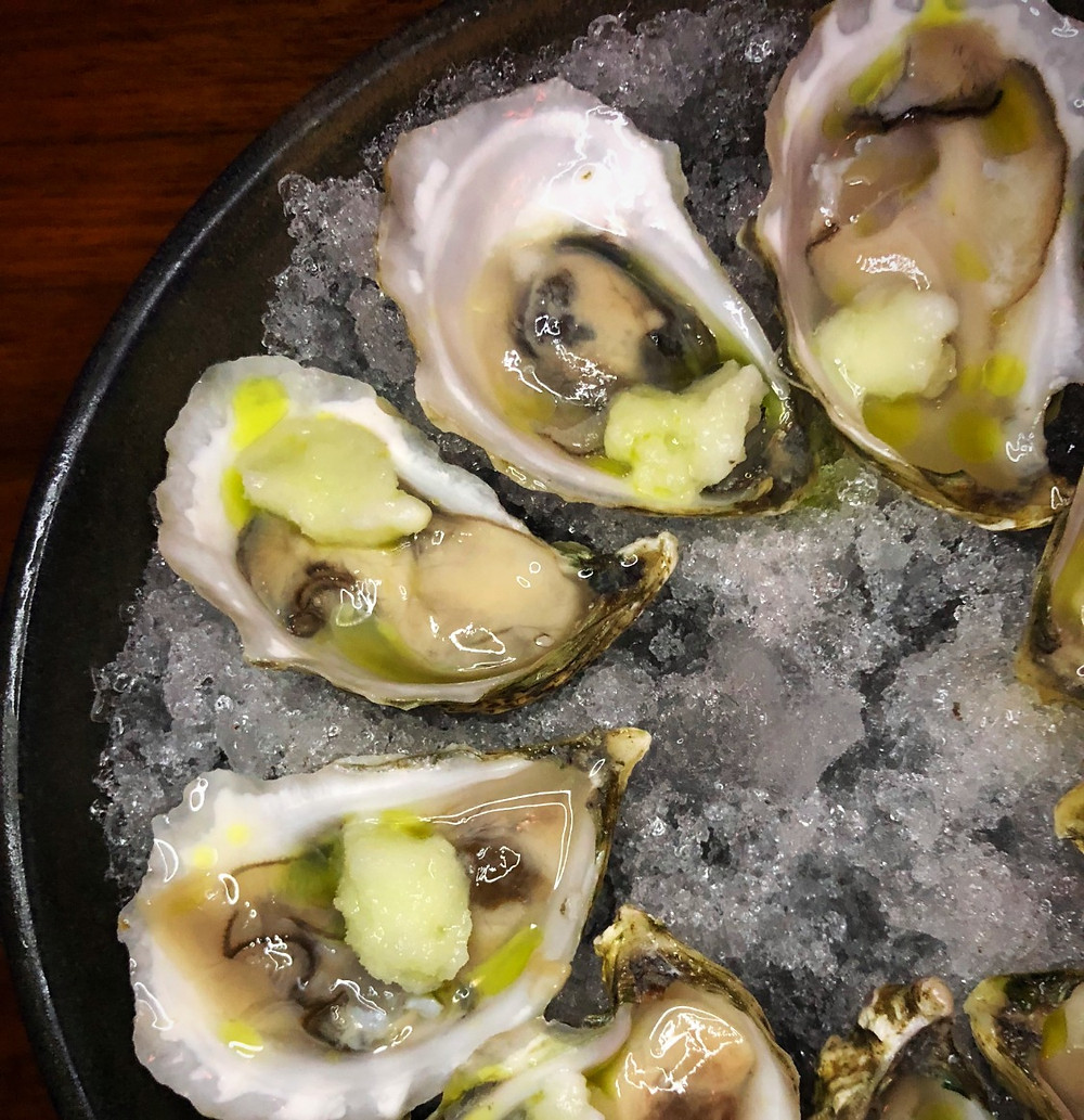 Oysters with honeydew sorbet and thai chili