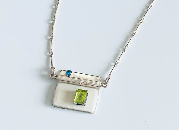 Sterling Silver, Ivory, and Blue Topaz Pendant