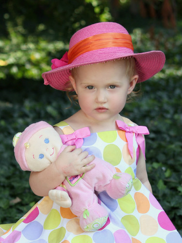 toddler kid photography holding doll pink hat polka dot dress columbia mo photographer family pictures