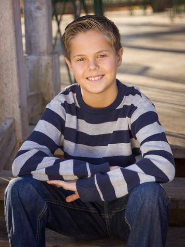 child kid photo poses sitting on steps striped shirt boy family photographer