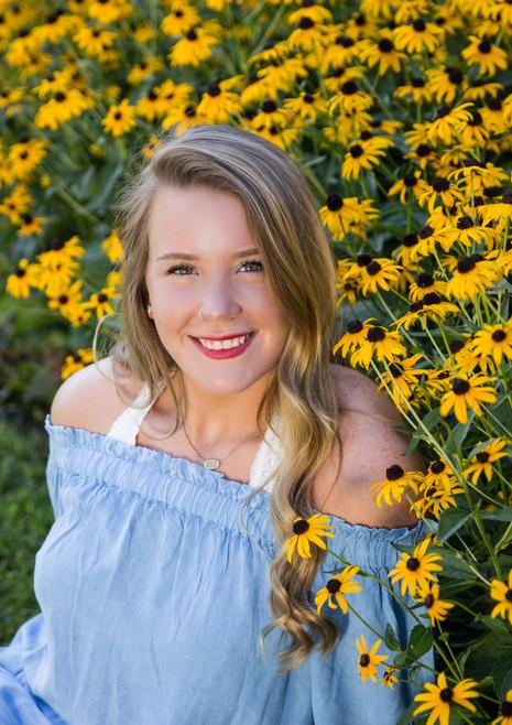 high school senior portraits columbia mo missouri yellow flowers