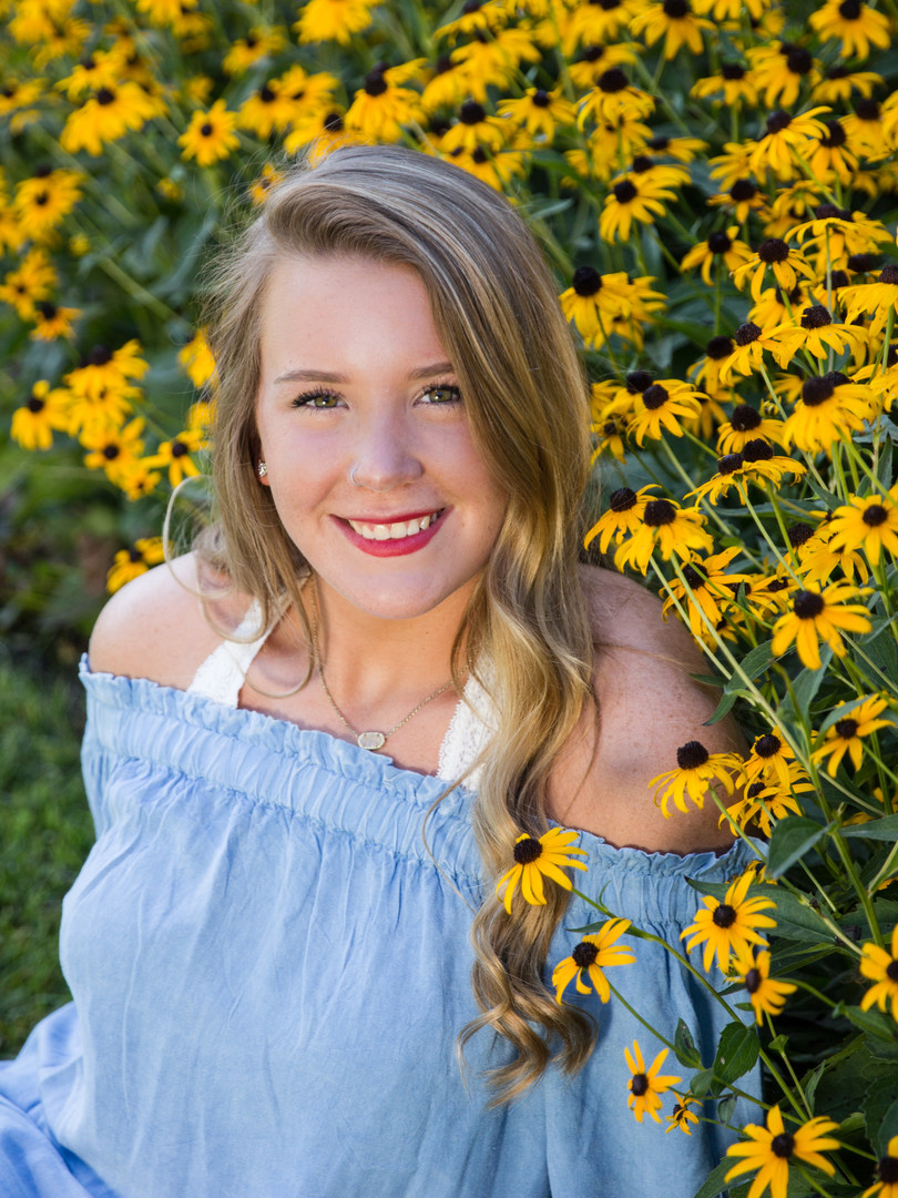 yellow flowers shelter garden high school senior pictures portraits columbia missouri photographer jefferson city ashland fulton boonville