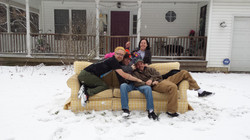 on a couch in the snow