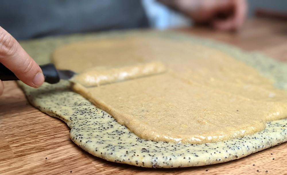 lemon butter mixture spread over the lemon poppy brioche dough
