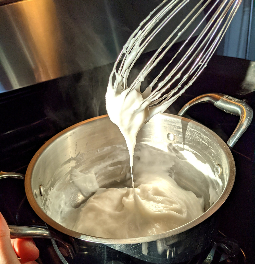 Once the cornstarch is added to the boiling coconut milk, the mixture almost instantly thickens