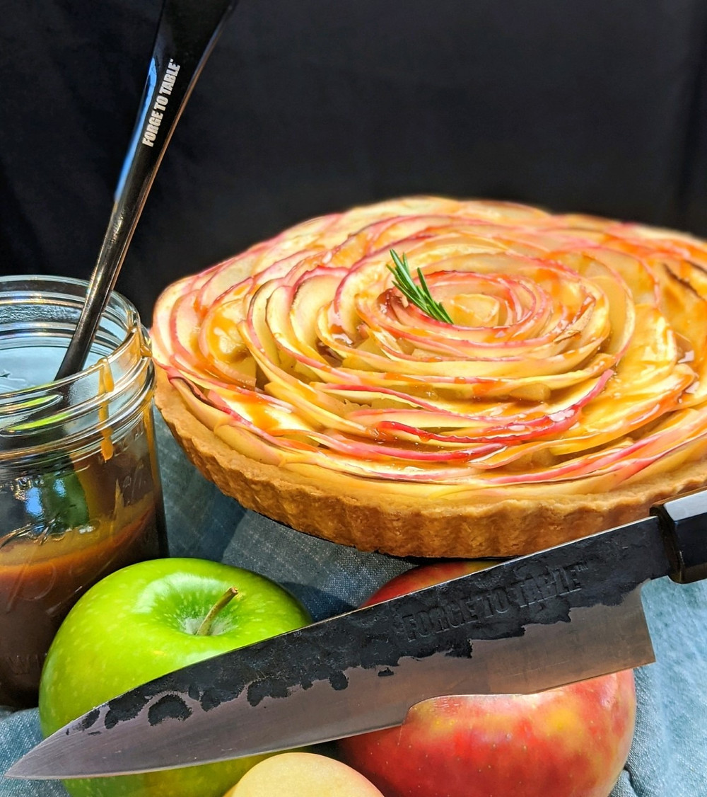 A beautiful swirled French apple tart dressed with homemade rosemary caramel