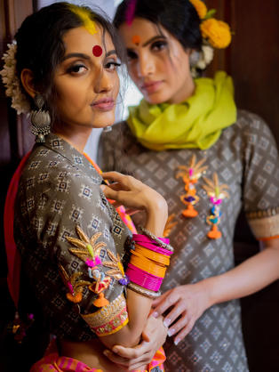 Hand Printed Ajrakh Kurta in Khadi with multi coloured hand crafted accessories teamed with Cotton Checks Saree