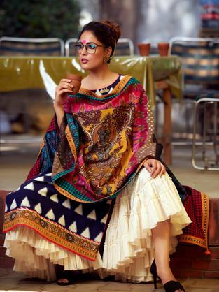 Multi Patch Dupatta with hand painted Kalamkari Krishna motif and variety of fabrics. Blue Ikat Kurta with triangular weave teamed with flared cotton sharara.