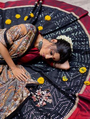 Pure Crepe hand painted Kalamkari dupatta with black Cotton Kataan Silk heavy mirror work skirt and wide Mahroon border