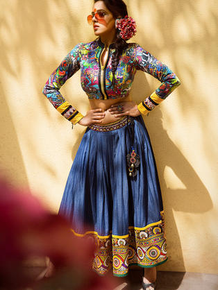 Graffiti digital printed Blouse with Rabari embroidery borders on sleeves. Cotton Denim Skirt with heavy Rabari embroidery.