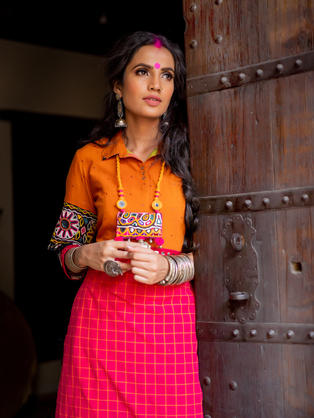 Orange-Red Suit with Mirror Belt and hand embroidered Gujarati Sleeves, styled with hand made Gujarati Neck piece
