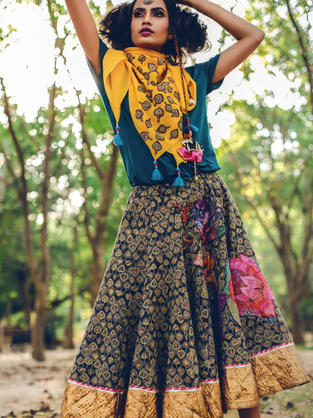 Block Printed Gore Flared skirt with Floral print applique in Kantha (Craft of Bengal) and broad Lappa in the hem. Stole in Yellow with applique of block printed cut outs and tassels.