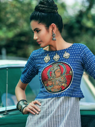 Blue mercerized Ikat Crop top with Kalamakari Appliqe in the front and embroidered motifs over a striped cotton sheath dress.