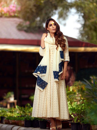 Off White flared long length suit in Jamdani woven fabric with off-white dupatta and Ikat panels of both the ends.