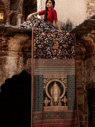 Kalamkari hand-painted saree with Balaji on the palla patched with Ajrakh Block Print. Body is hand painted Floral Kalamkari and Block Printed Triangular print in the skirt