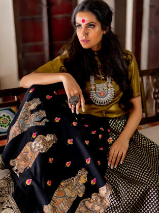 Gold shear Shirt in self checks with Black Silk Skirt paneled in Jacquard and appliqué of Kalamkari motifs with evenly placed embroidery motifs