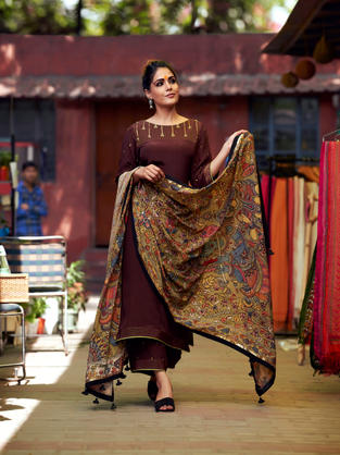 Brown Crepe Suit with embroidered yoke combined with hand painted Kalamakri dupatta in pure crepe.