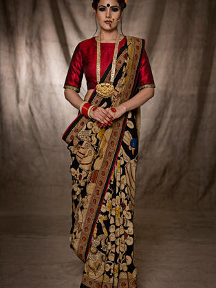 Hand Painted pure crepe Kalamakari saree with peacocks and Radha Krishna Motifs placed in a busy manner