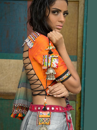 Raw Silk blouse with Rabari mirror embroidery on the back and sleeves. Saree is hand-loomed by the weavers of Kutch.