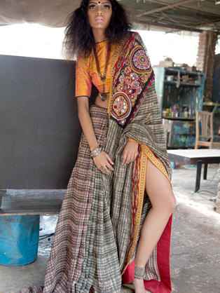 Hand woven linen saree with Ikat border and Rabari Mirror work Patch attached in the front.