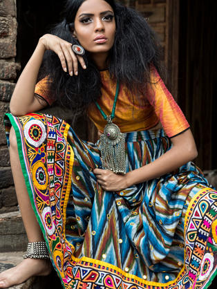 Multi Coloured Ikat skirt in cotton with heavy Hand embroidered Rabari border.