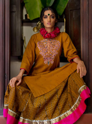 Hand Embroidery on Kala Cotton in Mustard and mirrors all over. Ikat Cotton Skirt with Magenta Silk border and Gota Ribbon
