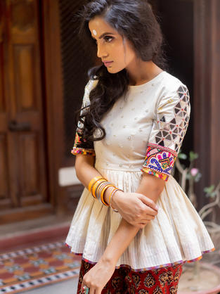 Off White Cotton Peplum Top with big triangular mirrors tessellation and Gujarati Embroiery teamed with Block Printed Pants