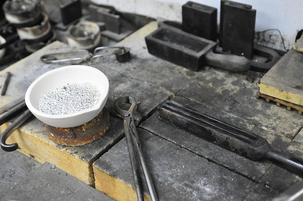 Silver shot in a crucible to be melted