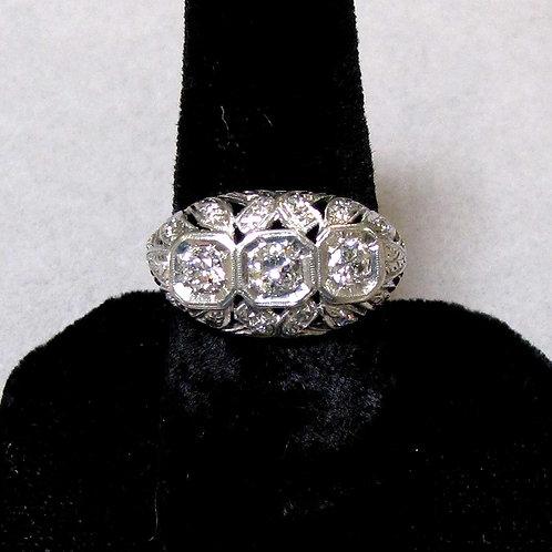 Antique Platinum Three-Diamond Engraved and Pierced Dome Ring