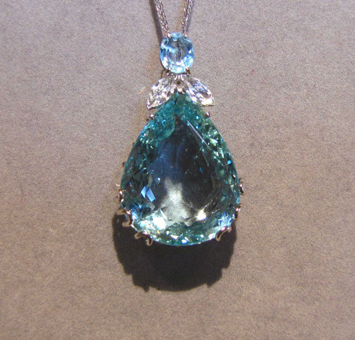 Large pear shape aquamarine diamond pendant viauestatejewelry 18k white gold pendant set with one large fine pear shape aquamarine 4314 cts and accented with two marquise shape diamonds 10 cts aloadofball Image collections