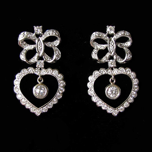 Fancy White Gold Diamond Heart and Bow Drop Earrings