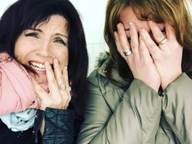 Two women covering their face during hockey tryouts.