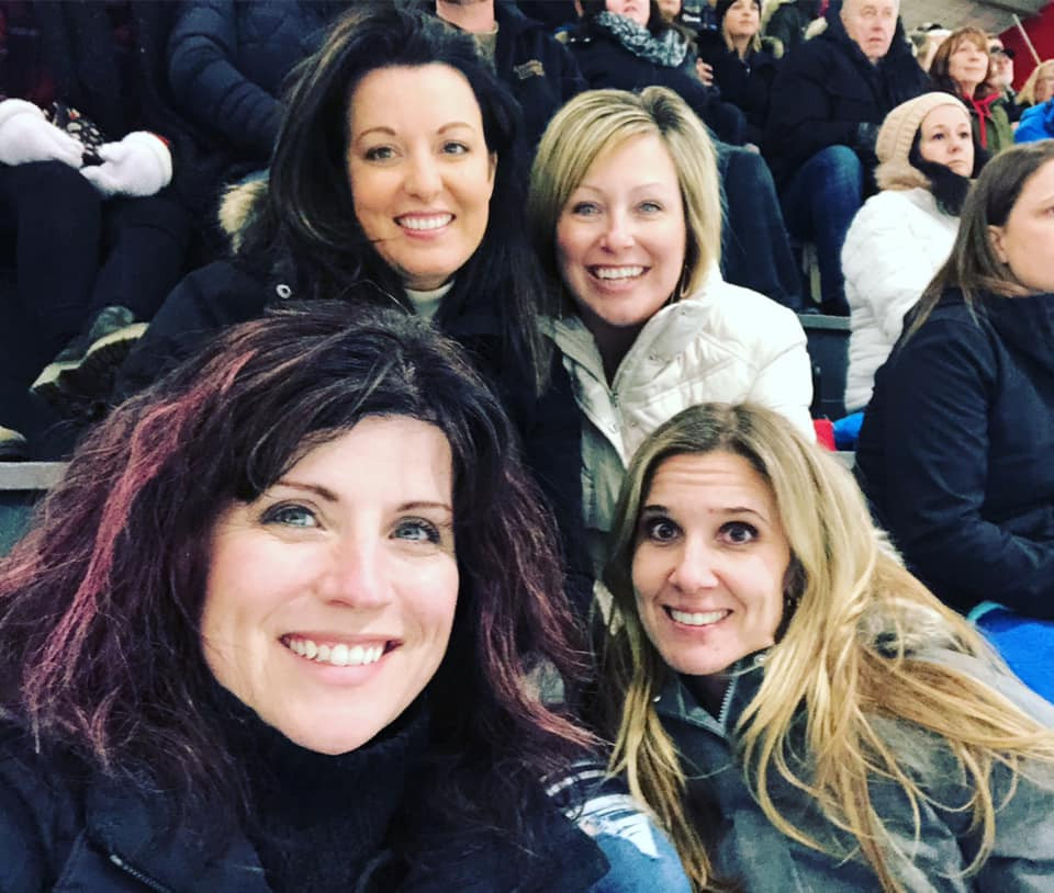 Four hockey moms at a minor hockey game in March 2020