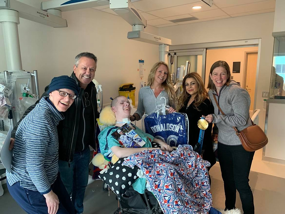 Toronto Maple Leafs hockey player Doug Gilmour visits a happy fan in hospital as director of The Angel Project