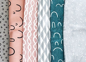 Realign Design can help you choose fabrics - an assortment of patterned fabrics