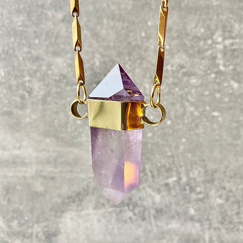 DOUBLE POINTED AMETHYST SET IN BRASS