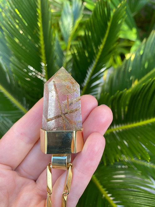 SMALL RUTILATED QUARTZ SET IN BRASS