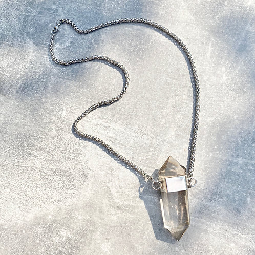 DOUBLE POINTED RUTILATED QUARTZ SET IN SILVER