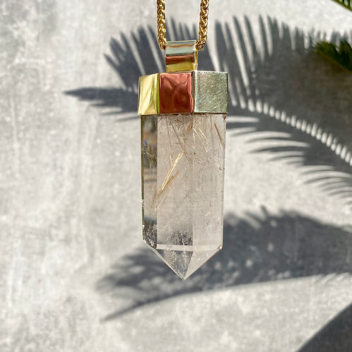 LARGE RUTILATED QUARTZ SET IN BRASS
