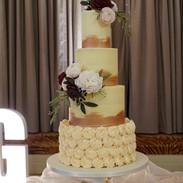 Elegant 4 tier buttercream wedding cake.